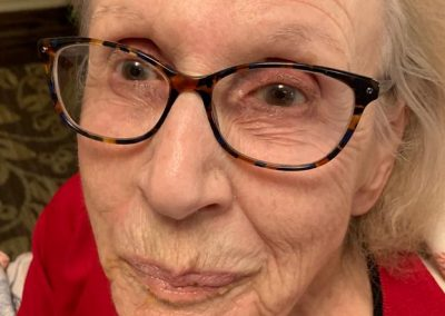portrait of elderly woman with tortoise shell glasses