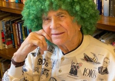 man poses with green wig