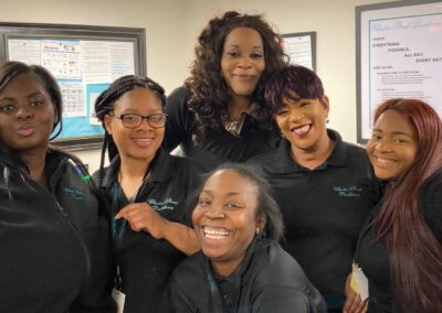 Chester Street staff smile in group photo