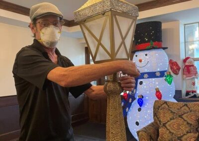 man in mask constructs holiday decorations