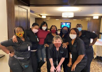 chester street staff members pose in masks